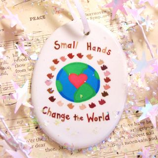 Small hands change the world - farah aria 2010 ornament 1